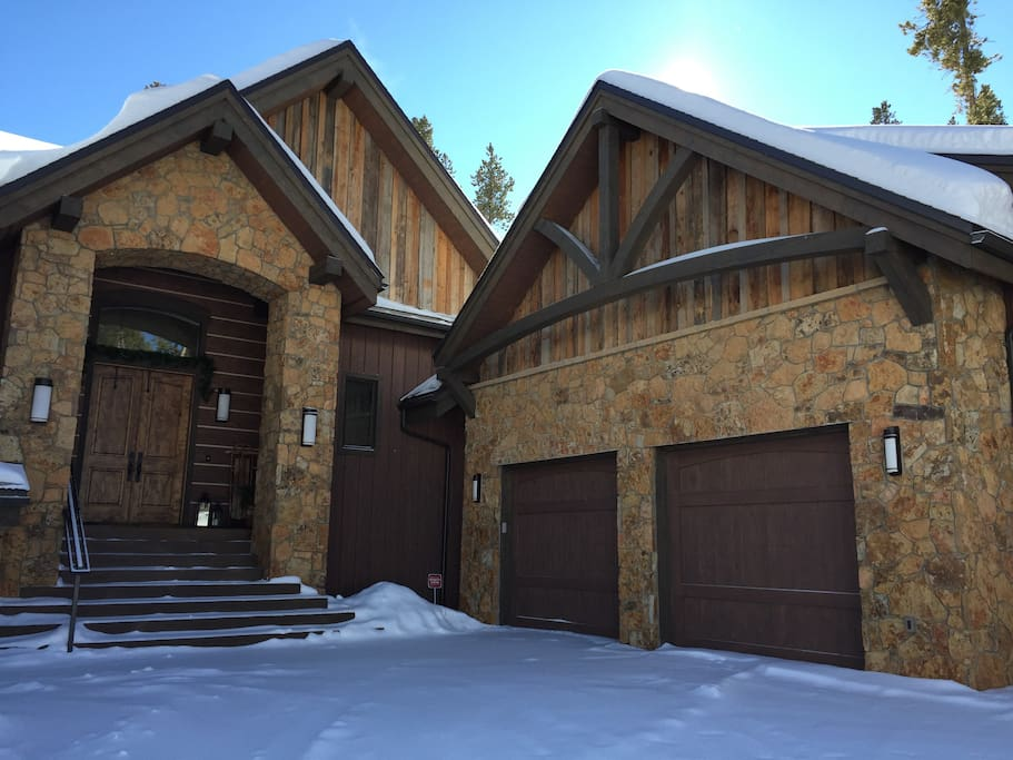 Plenty of parking available. Natural stone accents enrich this home