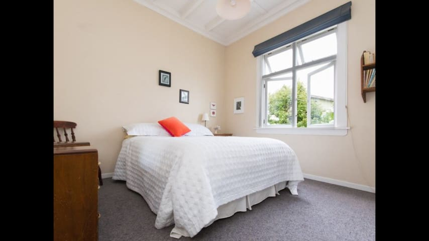 Large double bedroom in a sunny bungalow