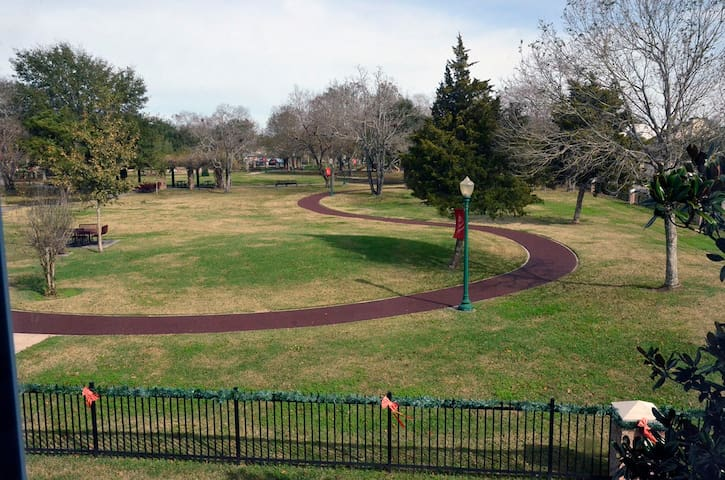Townhome faces park with jogging path and children's playground on site.