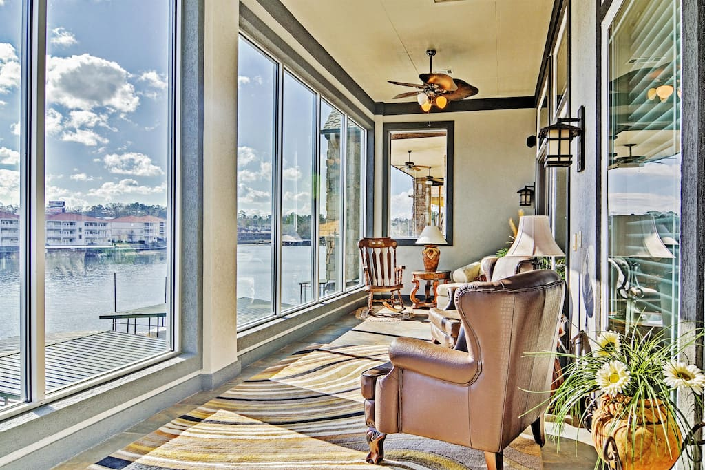 Unwind in the home's lovely sunroom and take in the marvelous lake views