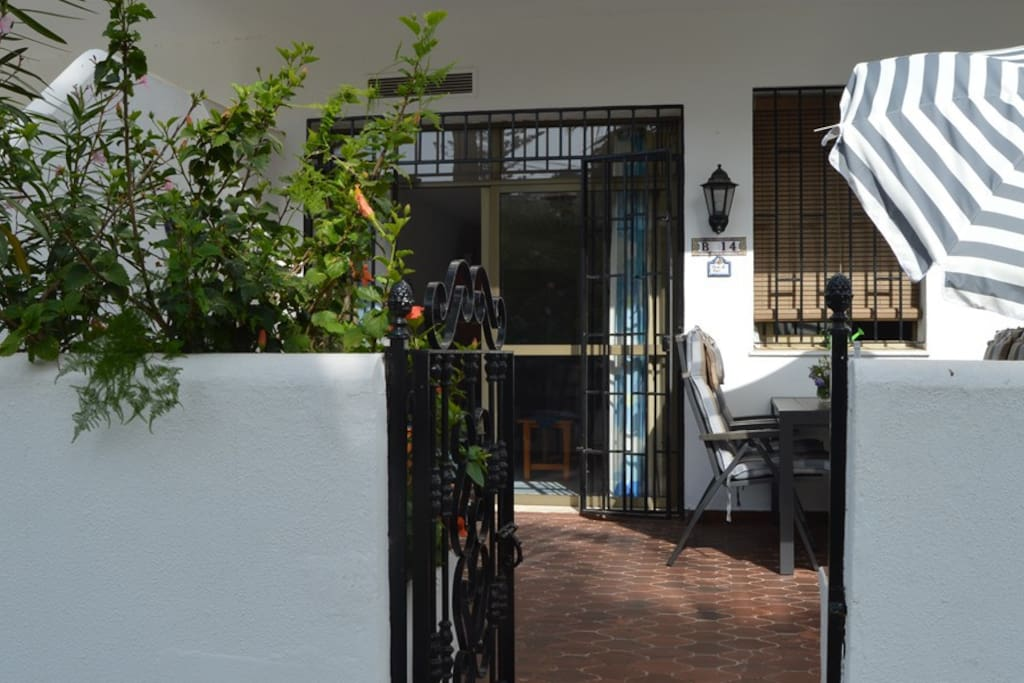 Patio leads out directly into the garden and has toldo for shade + umbrellas and tables and chairs