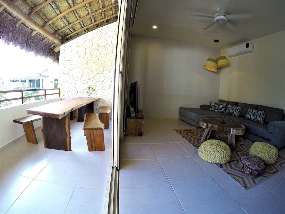 Split between living room and terrace with 9 foot table