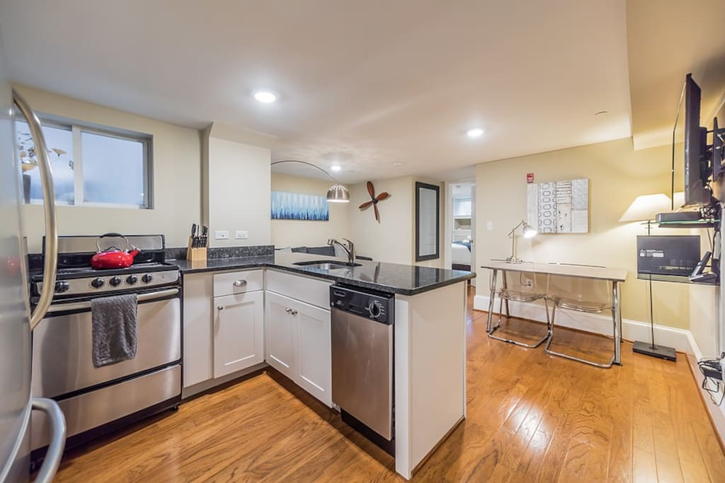 Fully equipped kitchen featuring stainless steel appliances as well as granite countertops