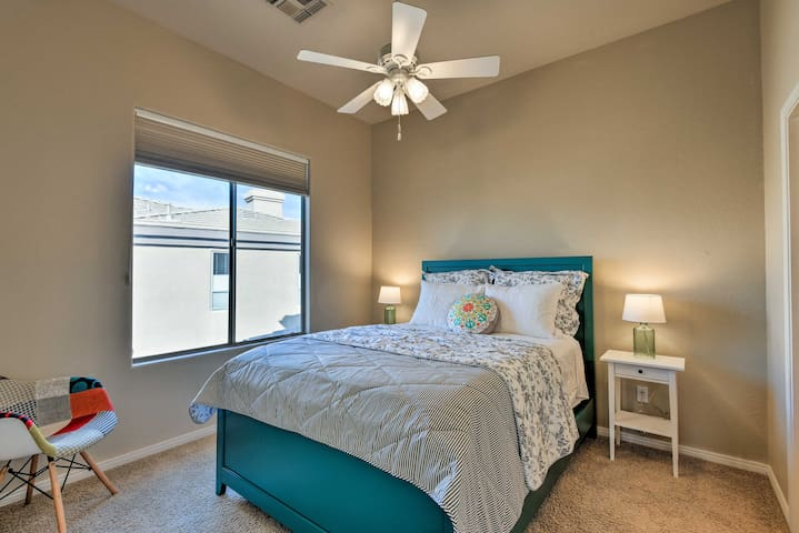 The second bedroom features a queen-sized bed and plenty of natural light.