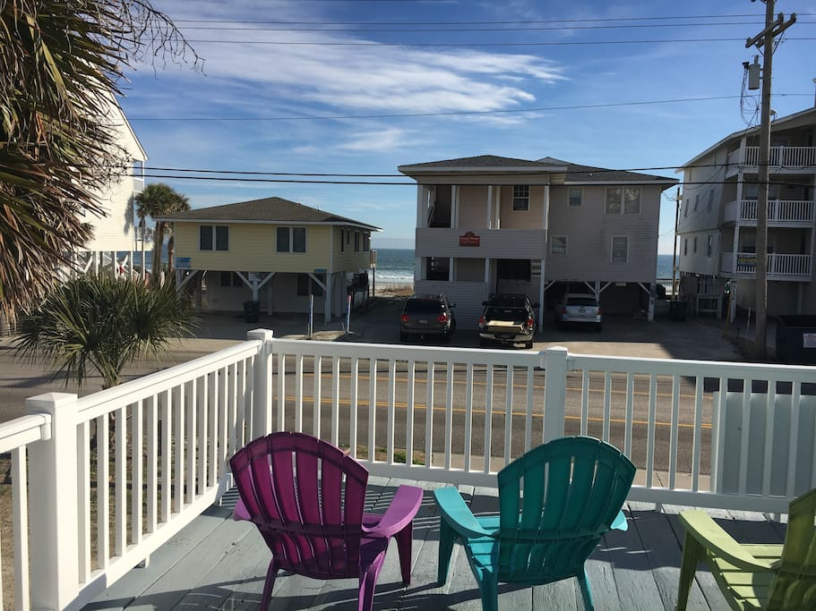 Enjoy the summer breeze sitting on this ocean view deck!  Only steps to the beach!