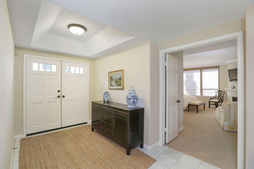 The spacious entryway leads to the master bedroom and the living room.