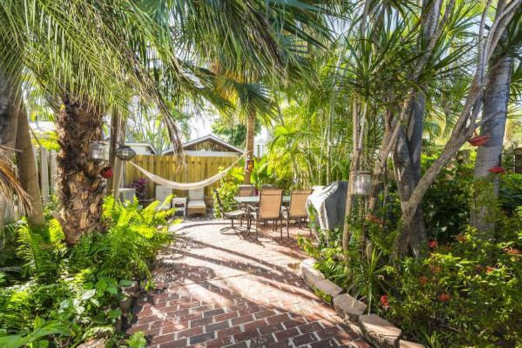 Large private garden with furniture, hammock and gas grill