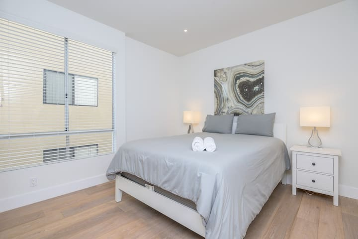 Master Bedroom with large mirrored closet and en-suite Bathroom  Queen size Bed.