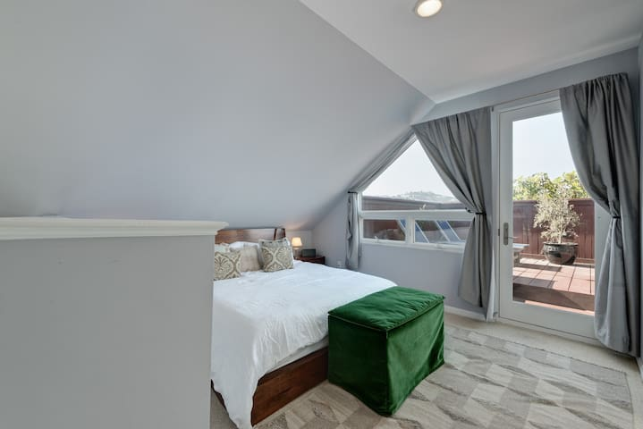 Master bedroom with cal king bed and roof deck with amazing views of twin peaks- very private and great for lounging in a robe after showering in the spa like bathroom!