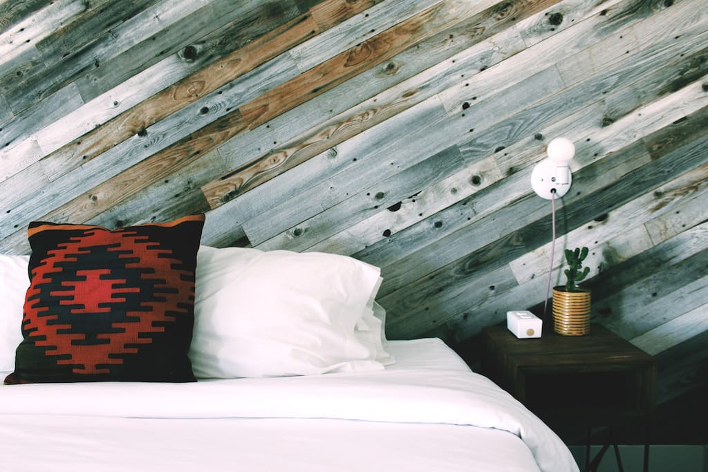 All the rooms are a little different.  This room uses reclaimed fencing on one wall.