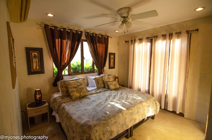 Main house downstairs bedroom, king configuration.  2 Single option available