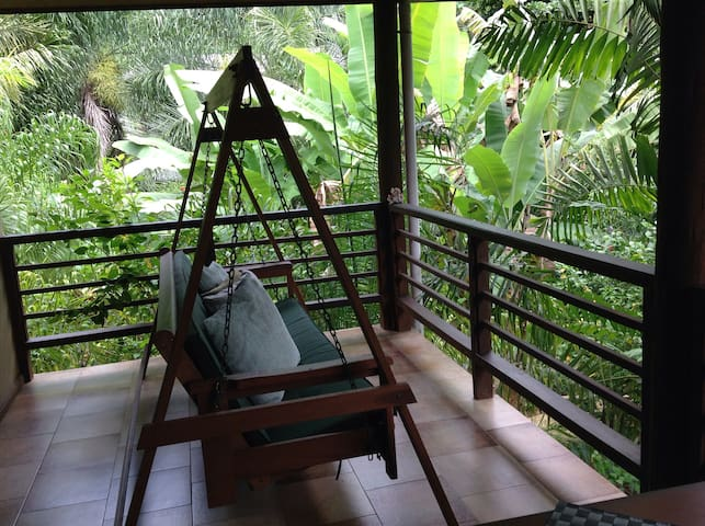 swing chair for two... The garden merging on your balcony, Relax and unwind after a day on the beach.