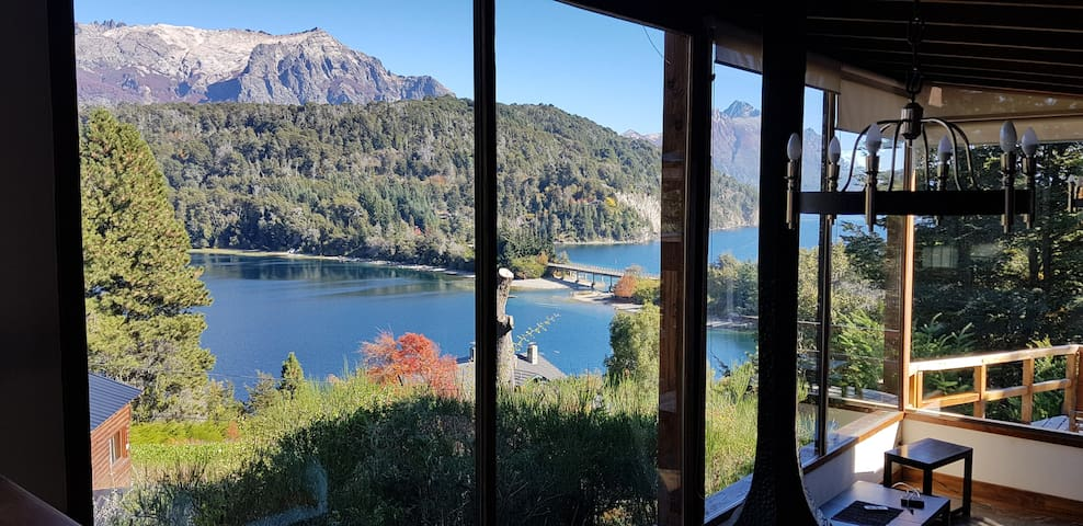 large windows allow you to see the mountains and the lake in all its splendor