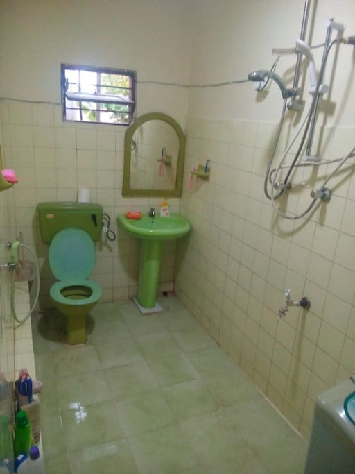 Bathroom with laundry facility and hot water