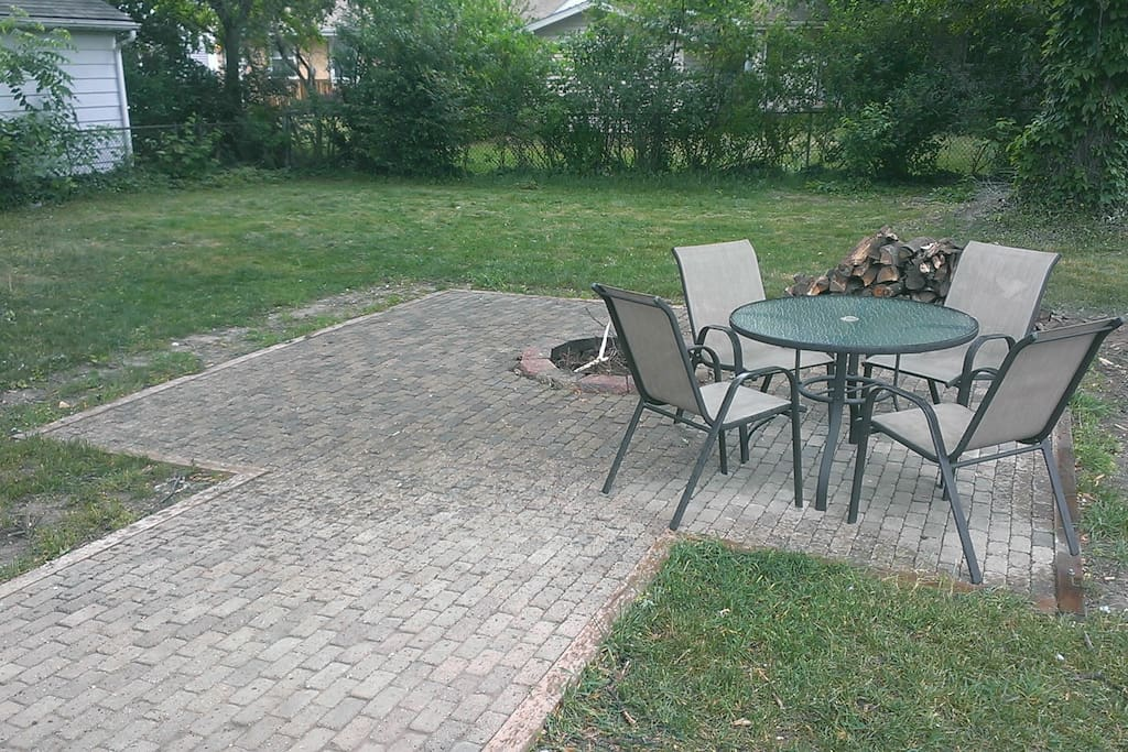 Spacious backyard with firepit