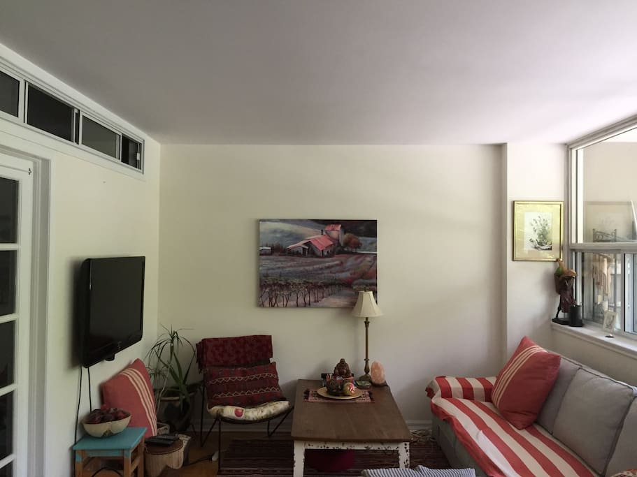 Cozy living space with couch (sleeps 1 if needed) and television (Apple TV with Netflix available)