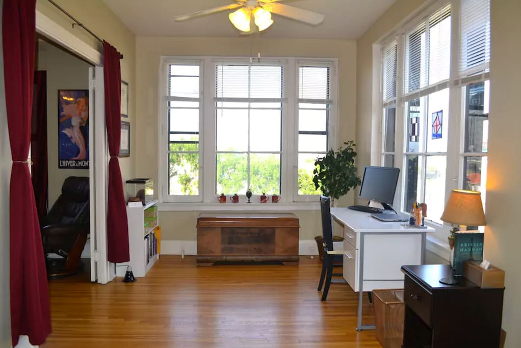 French double doors separate the sunny corner office + front bedroom from the living room.