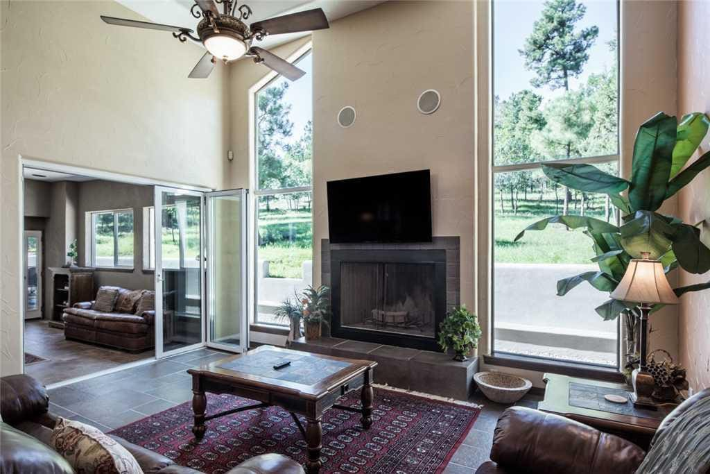 Vaulted ceilings and an open floor plan add to the ambiance of this luxurious property.
