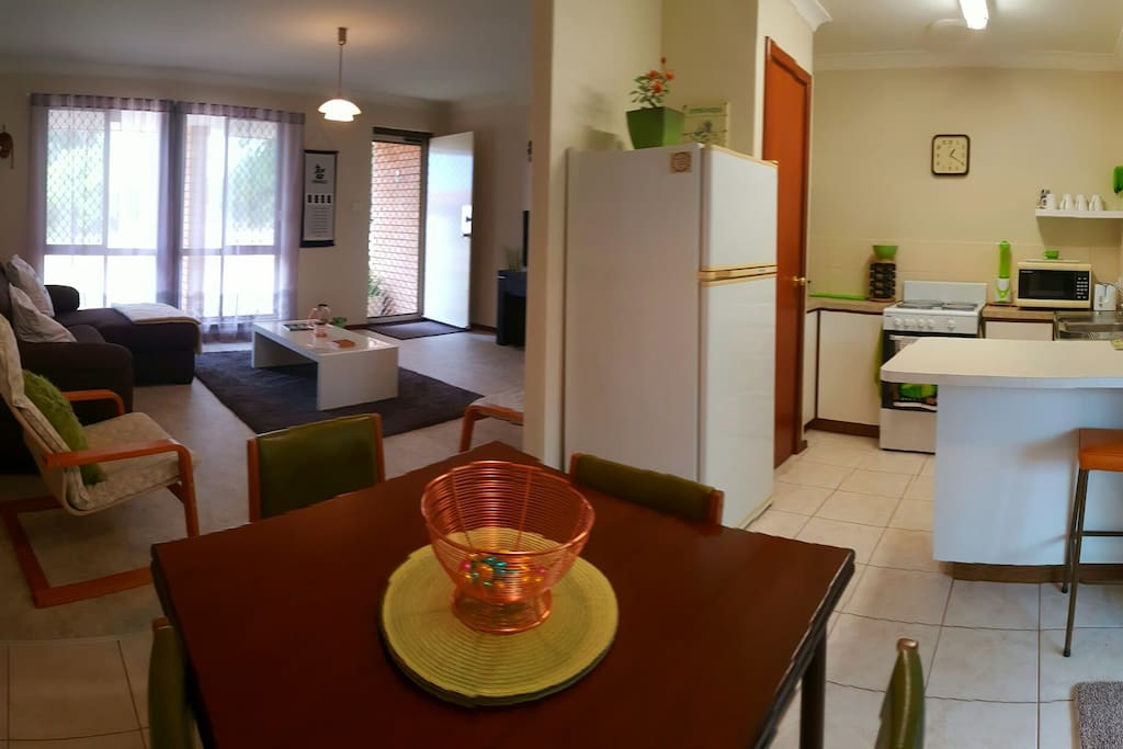 Self contained kitchen area, equipped with fridge, microwave, toaster and cooking utensils.
