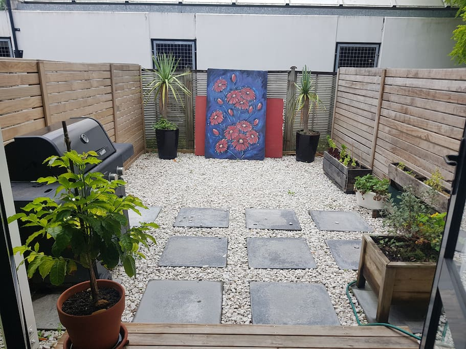 There's a private spacious backyard with a BBQ and some fresh herbs available.