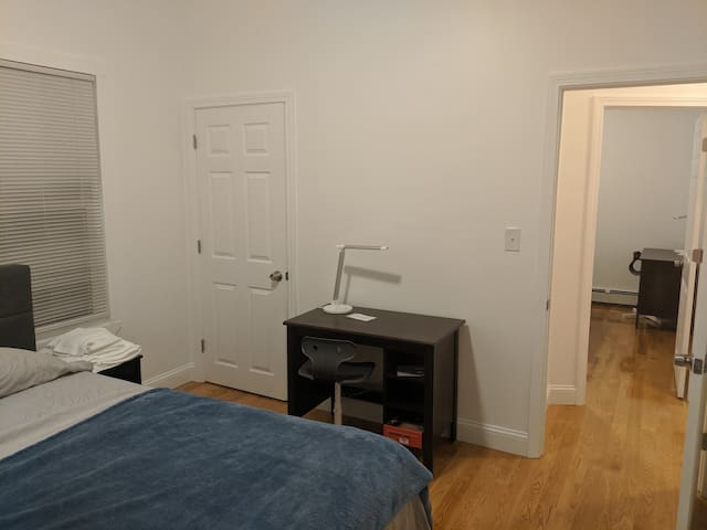 Huge closet, desk/chair/LED lamp, and nightstand in each bedroom