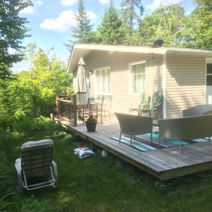 Cottage surrounded by deck adds more living space