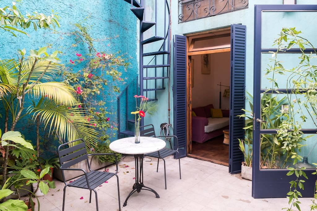 the patio is full of tropical plants, orquids, plumerias, white gingers, and many more.