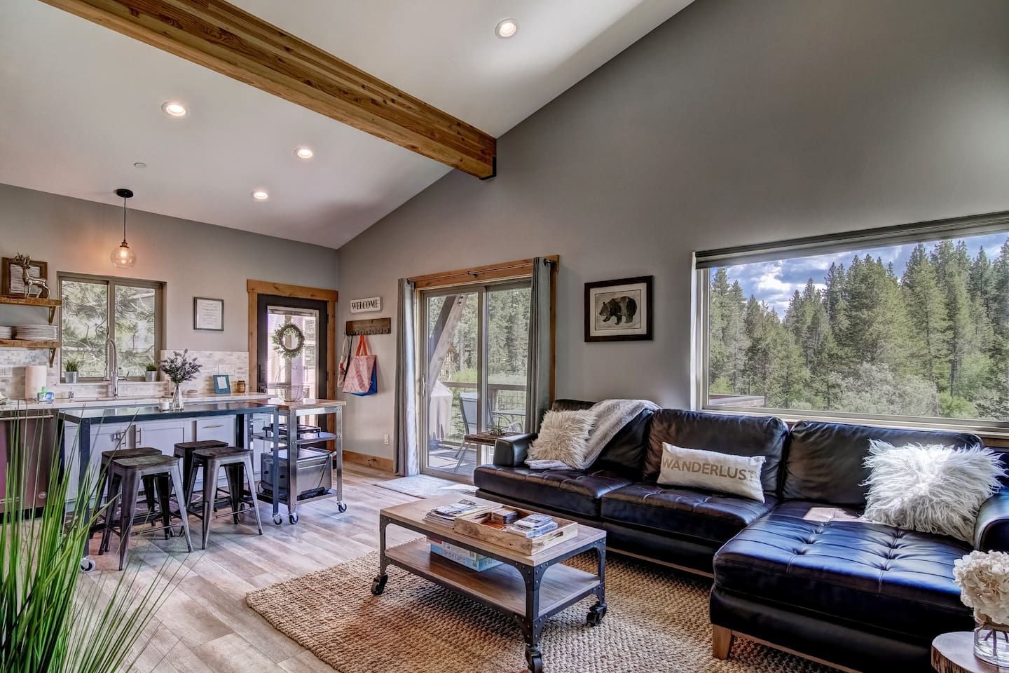 This is the main living area with views of forest and mountains