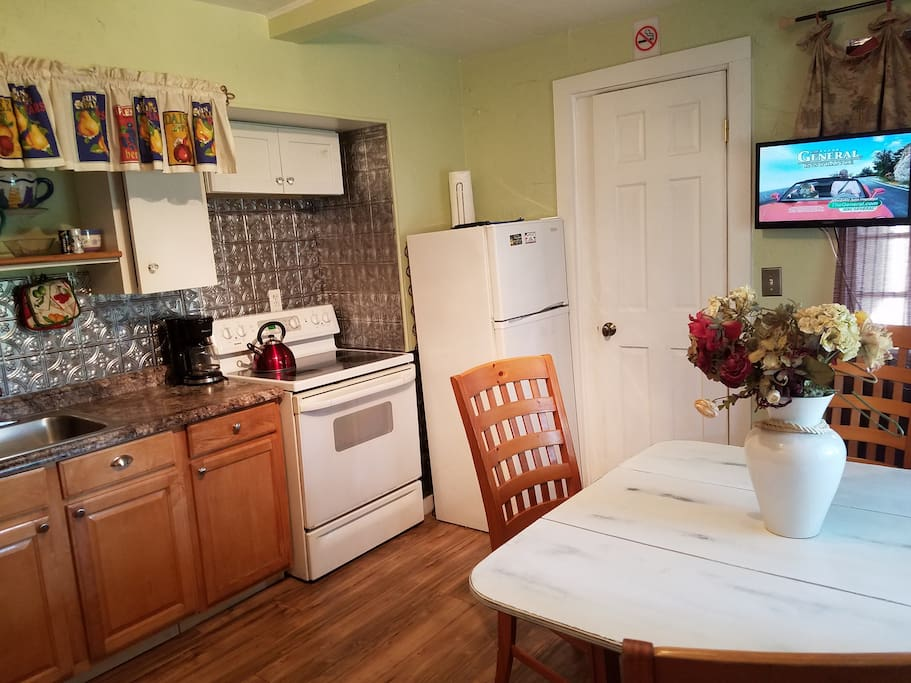 Walk in kitchen with door, also has Murphy wall bed and TV