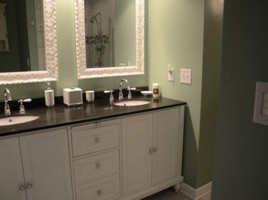 Master bathroom (dual vanity, shower, and clawfoot tub)