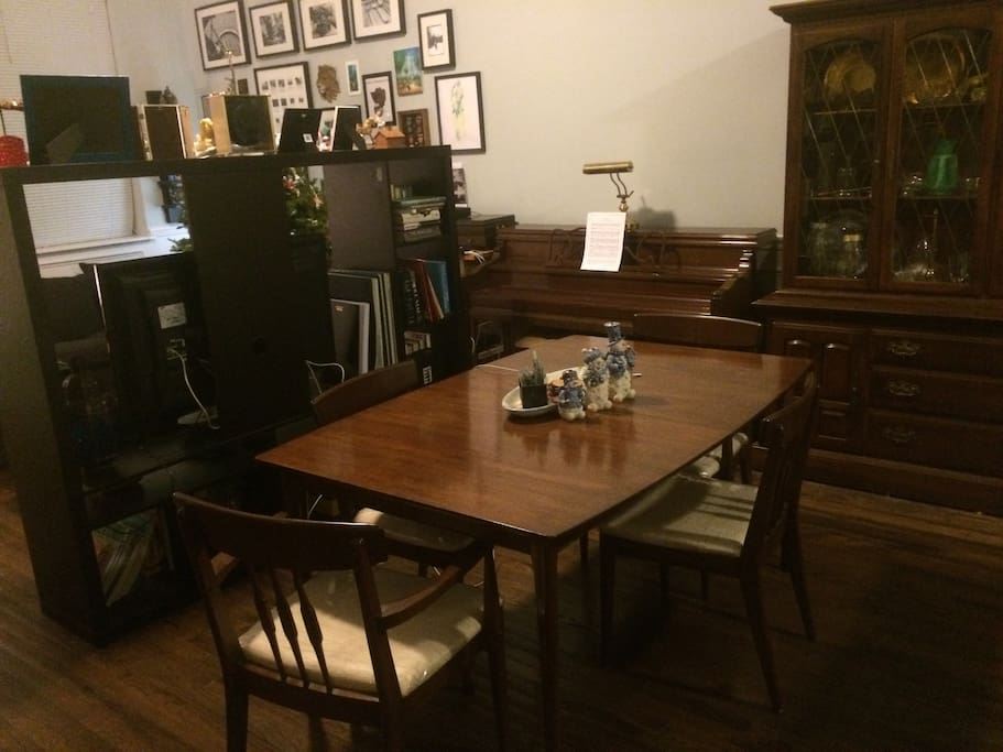 A dining table that seats 6 and a piano for after dinner sing-alongs