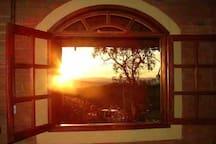 Vista da janela para o por do sol