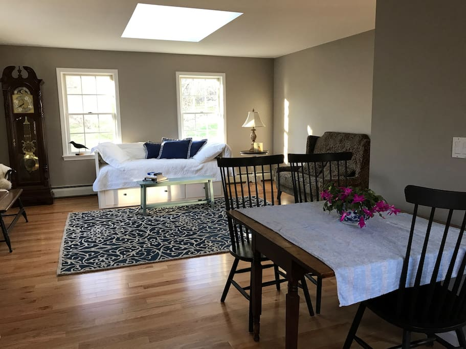 Spacious and open living room with skylight and lots of windows. Newly renovated with fresh paint and hardwood floors.