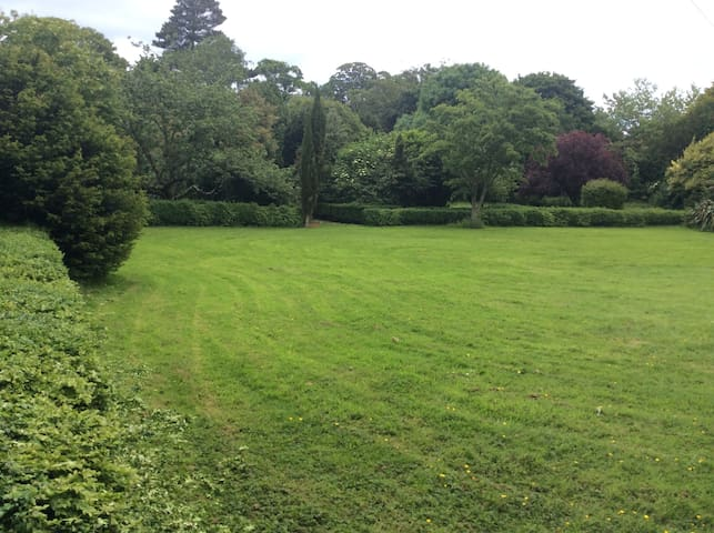 Lovely walled  secured one and a half acre garden perfect for dogs to run and play