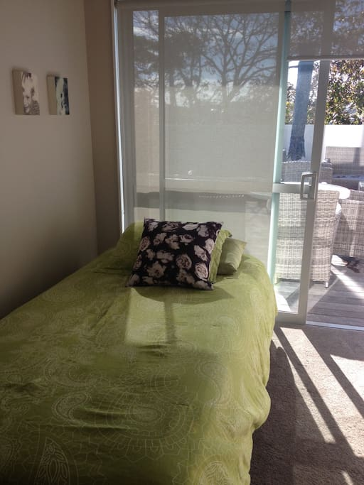 Guest room on ground level, King King Single.  Room opens to deck.  Trundle bed underneath if required