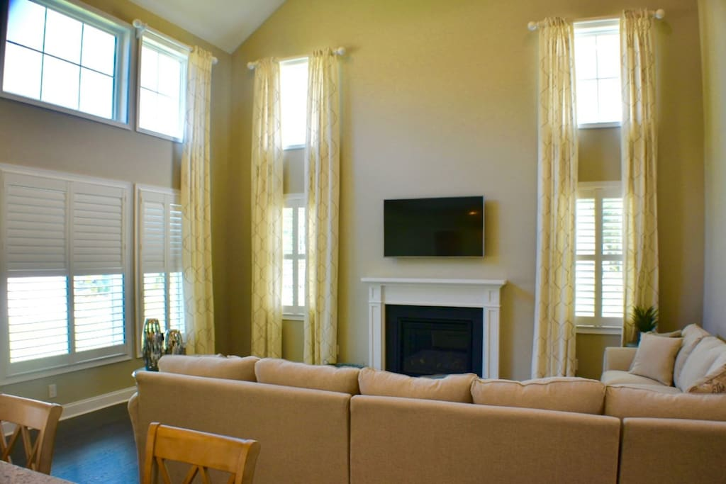 2 Story Family Room w HDTV and new couches as viewed from kitchen