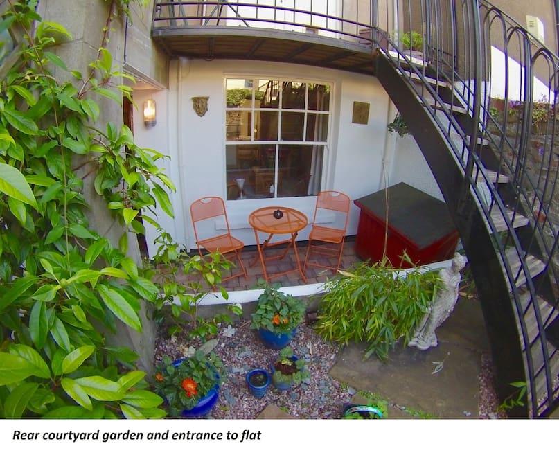 Rear courtyard garden and entrance to flat