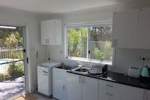 New kitchenette, with electric fry pan, rice cooker, microwave,  toaster kettle and a new washing machine. Don't use them all at once. No oven or cook top. The window is facing the reserve. Nobody is watching you. Privacy all around .