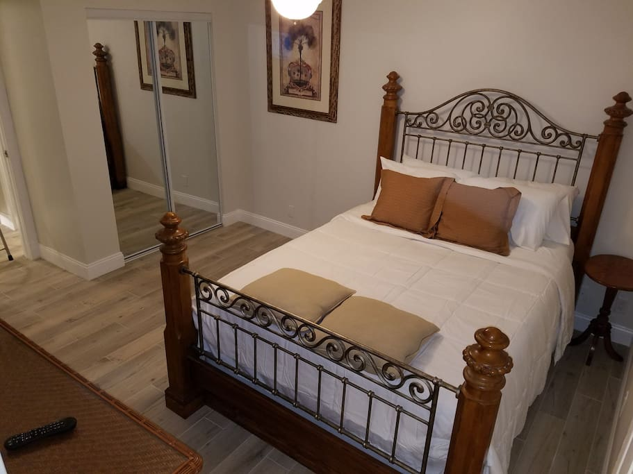 Beautiful Tommy Bahama style private bedroom with queen size bed, fresh linens, and plenty of extra pillows to wrap you in cozy comfort