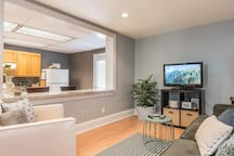 The breakfast bar looks into the living room so you can watch TV while you get down on breakfast burritos
