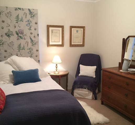 The bedroom - a king single bed and quality sheets and bedding and plenty of cushions for your comfort.