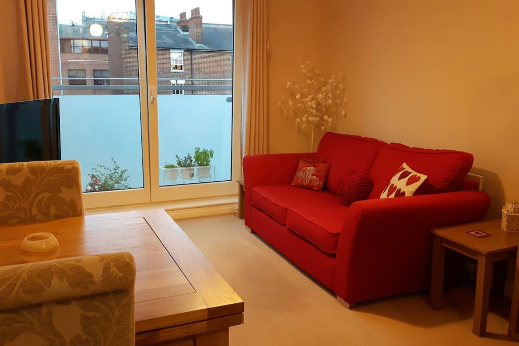 Double sofa bed. Dining room table (there are four chairs in the flat). Double doors can open fully for fresh air and to enjoy the sunshine.