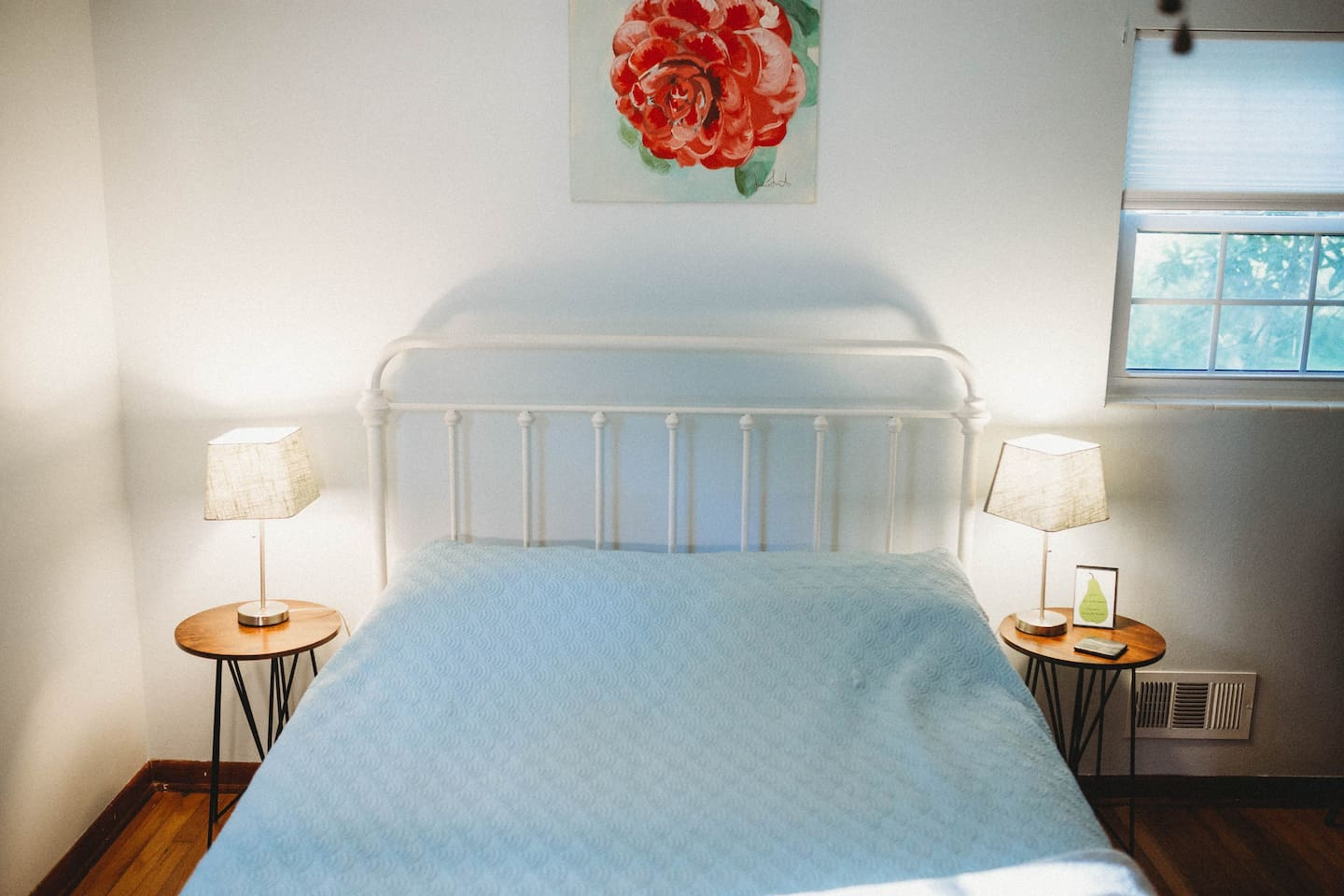 Here is a shot of your bed. Notice the camellia painting my friend painted above the bed? Our property has several camellia bushes in a variety of colors, and you'll see a lovely red one outside your bathroom window.