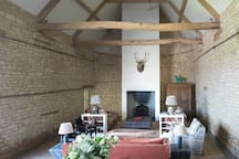 The lounge area but so much more when you step inside this room, never fails to impress our visitors. Your eyes are drawn up into the exposed beams which are bathed in natural light.  A lovely room for families and friends to relax.