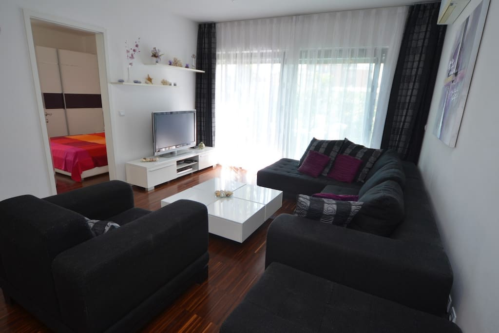 Spacious sunny living room, 50 meter square  including kitchen, dining room and 2 Air conditioner