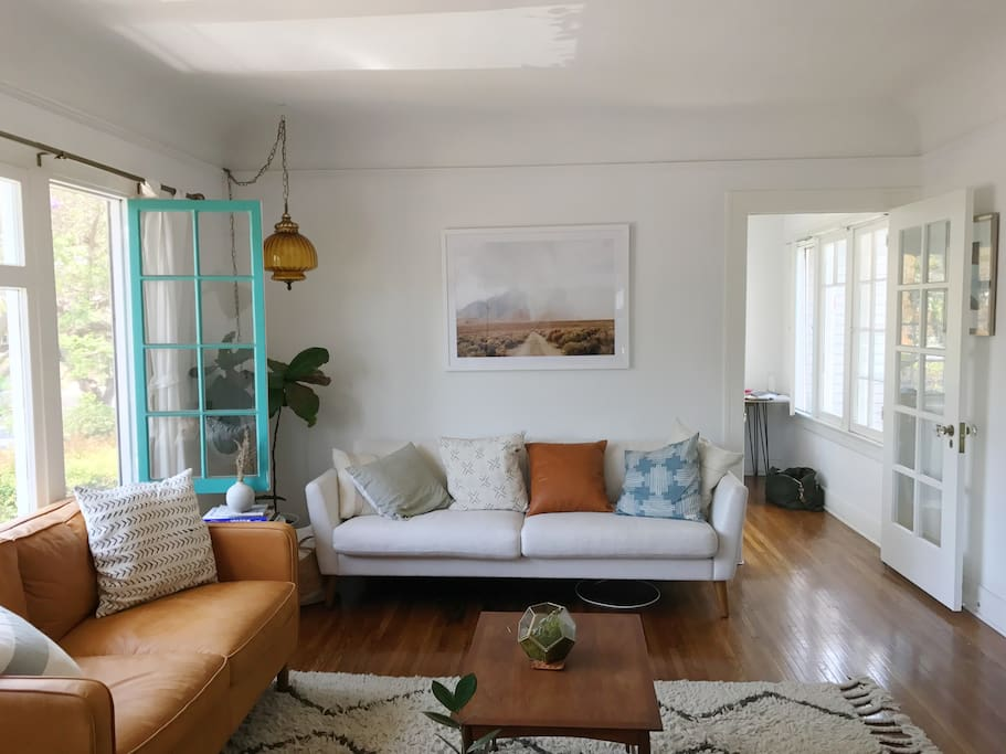 Cozy, and Comfortable living room with incredible daylight, record player, and a great space to relax.