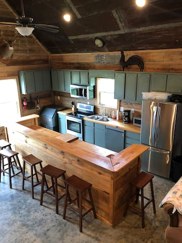 Kitchen with industrial ice maker, dishwasher, washer and dryer.