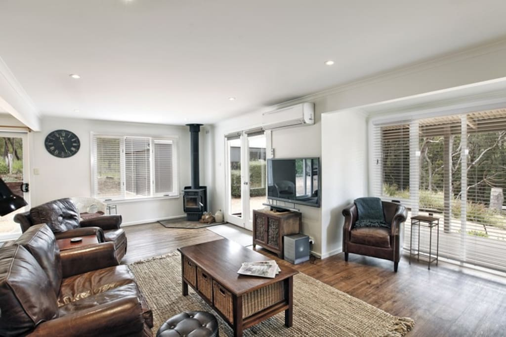 Cozy living room with Ned Kelly fireplace