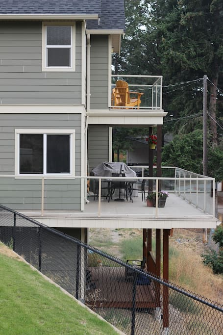 View from backyard of main deck & master bedroom patio