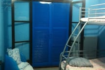Upstairs bedroom with 1 full size bed and 1 twin bunkbed